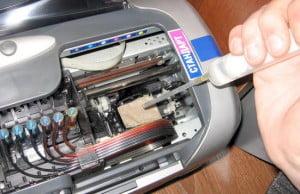 Как прочистить сопла в принтере?